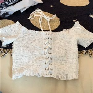Fitted white crop top with laces